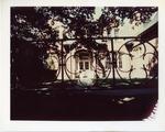 Antone Academic Center seen through a fence by Joseph Souza