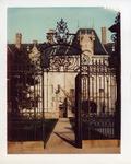 Front of Ochre Court seen through a gate