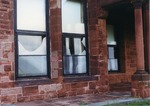 Broken window at McAuley Hall